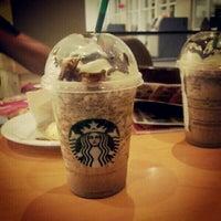Photo taken at Starbucks by Jessie M. on 4/9/2012