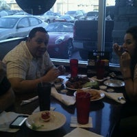 Photo taken at Tewbeleaux's Sports Bar & Grill by Yesenea M. on 3/28/2012