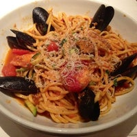 Photo taken at Romano's Macaroni Grill by Christian A. on 8/10/2012