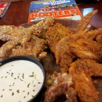 Photo taken at Hooters by Arnold T. on 2/20/2012