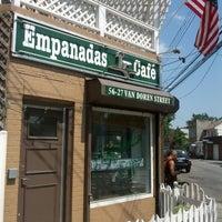 Photo taken at Empanadas Cafe by Brian K. on 7/4/2012