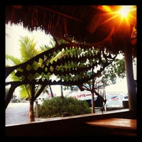 Photo taken at Hogfish Bar & Grill by Travis C. on 6/24/2012