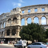 Photo taken at Arena Pula | The Pula Amphitheater by Simon M. on 7/23/2012