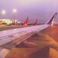 Photo taken at Gate 32A by Steve R. on 6/30/2012