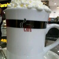Photo taken at Grande Café by Nat V. on 4/17/2012