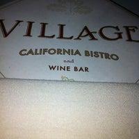 Photo taken at Village California Bistro & Wine Bar by Paris J. on 4/25/2012