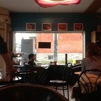 Photo taken at Umi Café by Chris A. on 4/26/2012