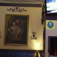 Photo taken at Merchants Cafe & Saloon by Jaci V. on 7/23/2012