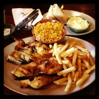 Photo taken at Nando's by Paul L. on 3/10/2012