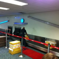 Photo taken at Baggage Claim by Leo T. on 8/7/2012