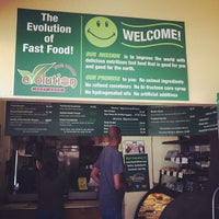 Photo taken at Evolution Fast Food by Kelly O. on 4/3/2012