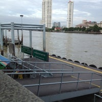 Photo taken at ท่าเรือสาทร (ตากสิน) Sathorn (Taksin) Pier CEN by Wanza Z. on 6/30/2012