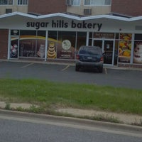 Photo taken at Sugar Hills Bakery by Monty N. on 5/30/2012