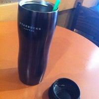 Photo taken at Starbucks by Keisuke K. on 8/10/2012