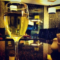 Photo taken at Aromas Café by Sanam D. on 2/19/2012