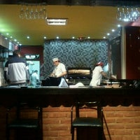 Photo taken at Pizza Hot Alsina by Julio P. on 7/4/2012