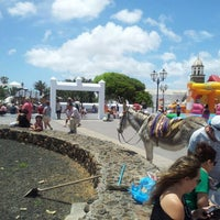 Photo taken at Mercadilllo de Teguise by Victor C. on 5/21/2012