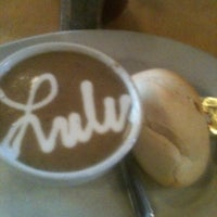 Photo taken at Lulu Cafe by Marcus S. on 7/7/2012