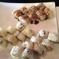Photo taken at Sushi Garden Restaurant by Casey B. on 2/29/2012