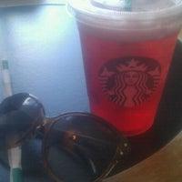 Photo taken at Starbucks by Emily E. on 5/21/2012