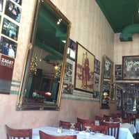 Photo taken at Carlitos Gardel Restaurant by Cj G. on 6/21/2012