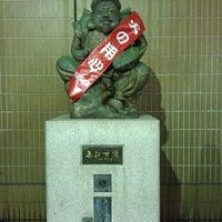 Photo taken at えびす像 by iwamoto on 3/1/2012
