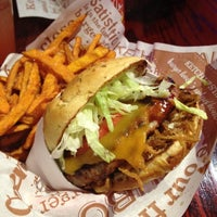 Photo taken at Red Robin Gourmet Burgers by Christina A. on 5/22/2012