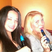 Photo taken at Oasis Cafe And Hookah Lounge by Lindsey K. on 3/24/2012