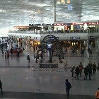 Photo taken at Beijing Capital International Airport (PEK) by Oleg D. on 4/6/2012