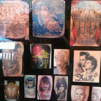 Photo taken at Inkstop Tattoo by Kitty s. on 6/2/2012
