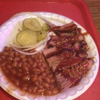 Photo taken at Augie's Barbed Wire Smokehouse by Sean H. on 3/4/2012