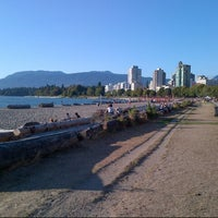Photo taken at English Bay Beach by Marc C. on 9/4/2012