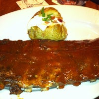 Photo taken at Outback Steakhouse by Jamille B. on 7/29/2012