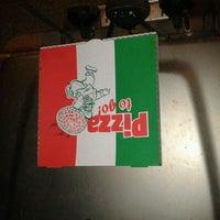 Photo taken at John's Pizza Bar & Restaurant by TC on 4/26/2012