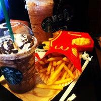 Photo taken at Starbucks Coffee by Julie B. on 6/23/2012