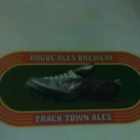 Photo taken at Rogue Ales Public House & Brewery by Morgan S. on 6/26/2012