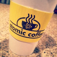Photo taken at Atomic Coffee by Mike S. on 3/30/2012
