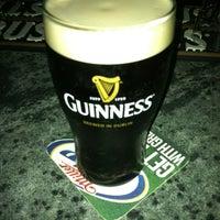 Photo taken at Mulligan's Irish Pub by Ryan B. on 3/23/2012