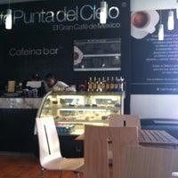 Photo taken at Café Punta Del Cielo by José Luis R. on 3/25/2012
