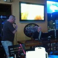 Photo taken at Pott's Sports Cafe by Chaz C. on 8/2/2012