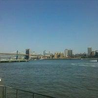 Photo taken at East River Esplanade by Reggie J. on 3/19/2012