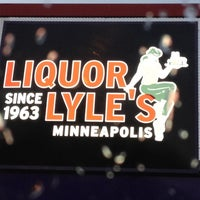 Photo taken at Liquor Lyle's by Kacie G. on 5/12/2012