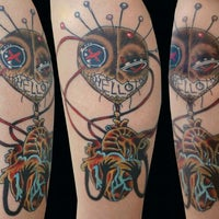 Photo taken at House Of Pain Tattoo by Ms. Carolyn E. on 11/15/2011