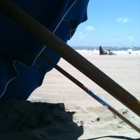 Photo taken at 59th St Beach by Natalie F. on 6/14/2012