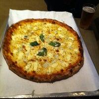 Photo taken at Basic Urban Kitchen & Bar by Kay C. on 8/28/2012