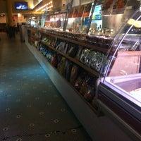 Photo taken at Cafe Mercato by kenia c. on 3/7/2012