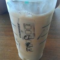 Photo taken at Starbucks by Tesia K. on 6/9/2012