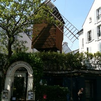Photo taken at Le Moulin de la Galette by Andreas D. on 5/23/2012