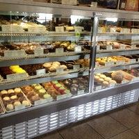 Photo taken at Crumbs Bake Shop by Mathew on 8/4/2012
