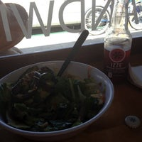 Photo taken at Olives Gourmet Grocer by Jenny D. on 4/10/2012